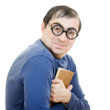 Student in glasses carefully pressed to his breast a book on white background Stock Photo - 12388039