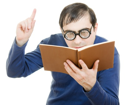 Student in glasses reading a book on white background Stock Photo - 12388035