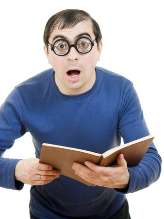 Student in glasses reading a book on white background photo
