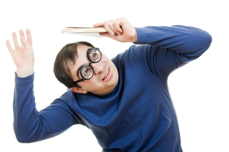 Student in glasses with a book over his head on white background Stock Photo - 12388118