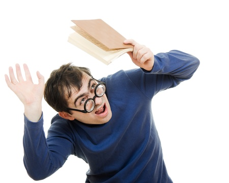 Student in glasses with a book over his head on white background photo