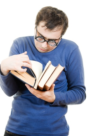 Student in glasses reading a book on white background Stock Photo - 12388063