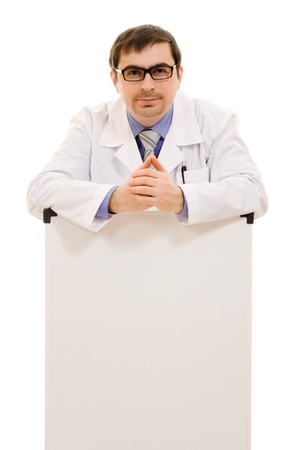 Male doctor with a white board on a white background. photo