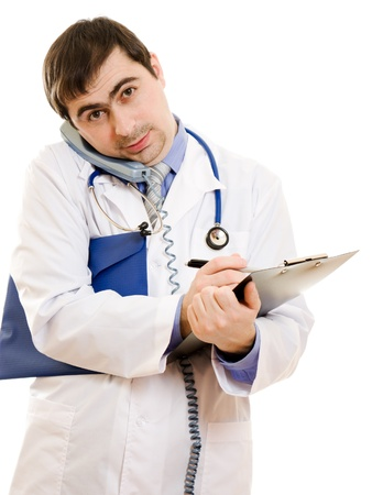 Male doctor talking on the phone and writing on the document plate on a white background.