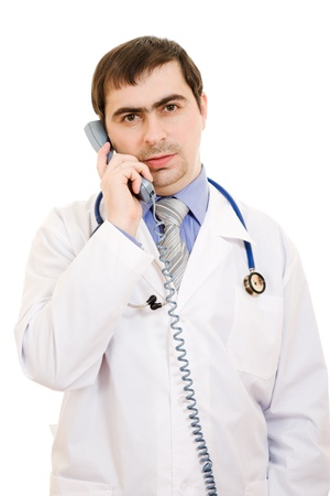 Male doctor talking on the phone on a white background. photo