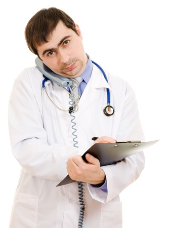 Male doctor talking on the phone and writing on the document plate on a white background. photo