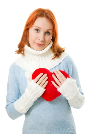 Beautiful girl in warm clothes with a heart  photo