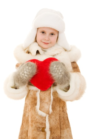 nestle: Girl in warm clothing holding the heart in his hands on a white background  Stock Photo
