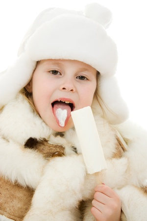 The girl in warm clothes eating ice cream on white background. photo