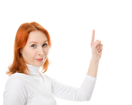 A beautiful girl with red hair shows thumb up on a white background. photo