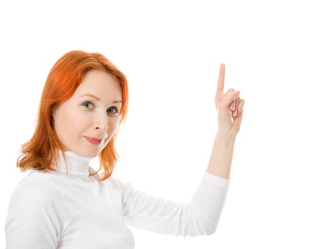 A beautiful girl with red hair shows thumb up on a white background. Stock Photo - 12712054