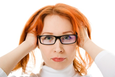 A beautiful girl with red hair wearing glasses on white background. photo