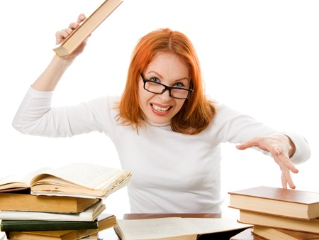 Beautiful red-haired girl in glasses reads book on a white background. Stock Photo - 12712166