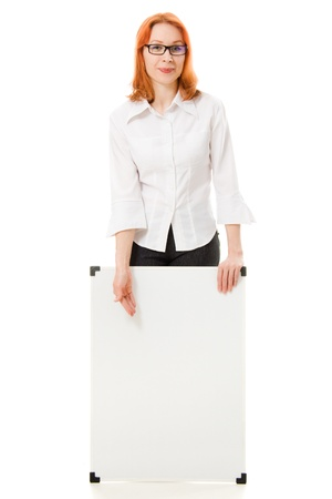 Young businesswoman showing blank signboard, on a white background. photo