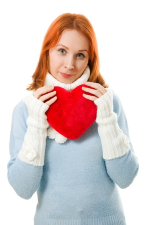 Beautiful girl in warm clothes with a heart Stock Photo - 12712326