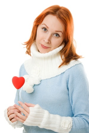 Beautiful girl in warm clothes with a heart on a white background. Stock Photo - 12712327