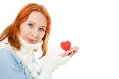 Beautiful girl in warm clothes with a heart on a white background. Stock Photo - 12712130