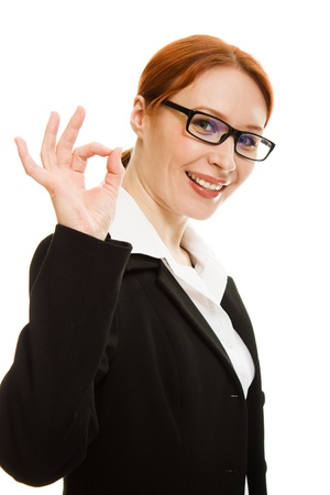 Smiling business woman gesture shows okay isolated over white background photo