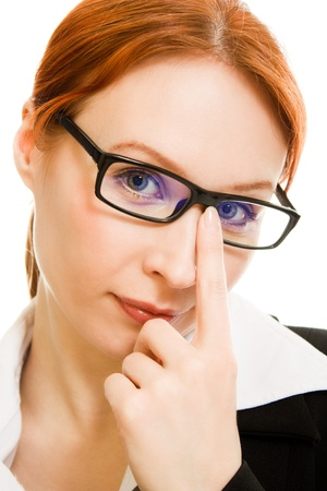 Businesswoman in glasses with red hair on a white background. photo