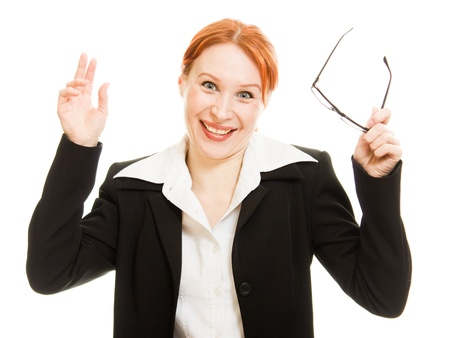 Businesswoman in glasses with the red hair was surprised on a white background. photo