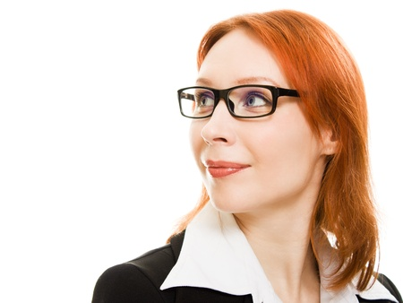 Businesswoman in glasses with the red hair looks away on a white background. photo