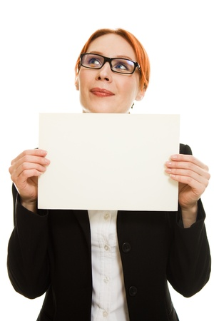 BusineBusiness Woman in glasses with the red haired showing blank signboard on a white background.sswoman in glasses with the red hair photo