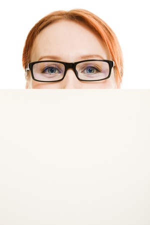 business woman with glasses hidden behind a white sheet of paper Stock Photo - 12896007