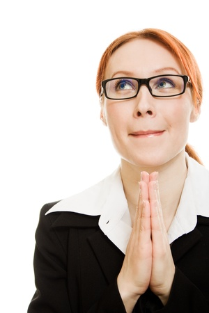 Praying businesswoman with suit on a white background. photo