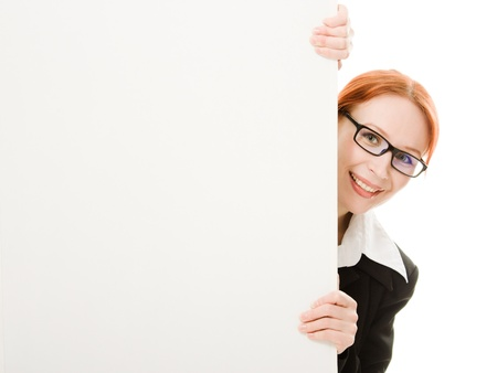 business woman with glasses hidden behind a white sheet of paper photo