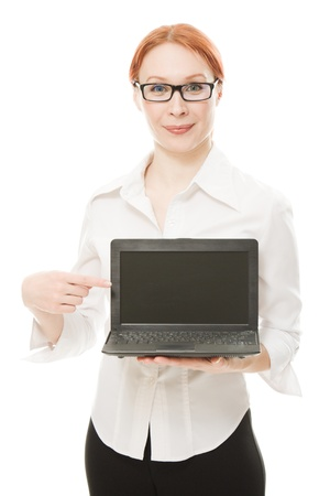 Beautiful woman with red hair wearing glasses with a laptop in the hands of a white background. photo
