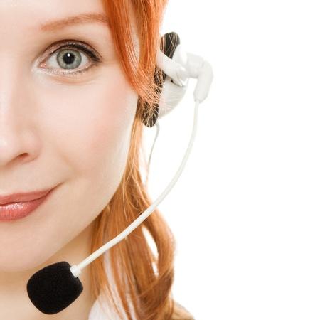 telephone headsets: Hermosa mujer de negocios con el auricular en un fondo blanco.