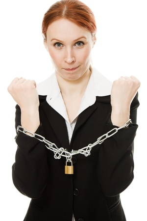 Businesswoman with her ??hands shackled in chains on a white background. photo