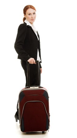 Businesswoman with a suitcase on a white background. photo
