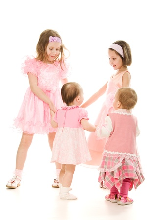 Four friends in a pink dress plays on a white background. photo