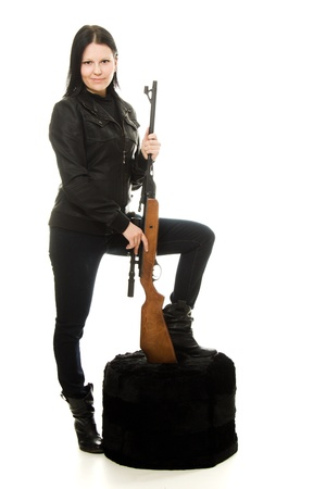 Cowgirl with a gun on a white background. photo