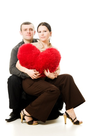 Man and woman with a heart in his hands on a white background photo
