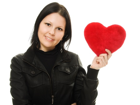 Beautiful smiling woman with a gift in the form of heart in his hands photo