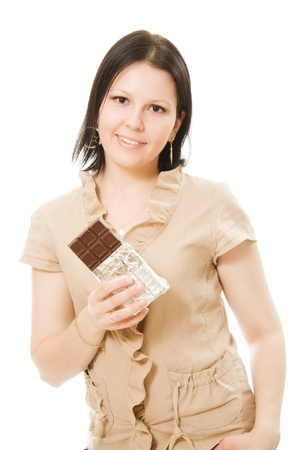 portrait of beautiful woman with a chocolate on a white background. photo