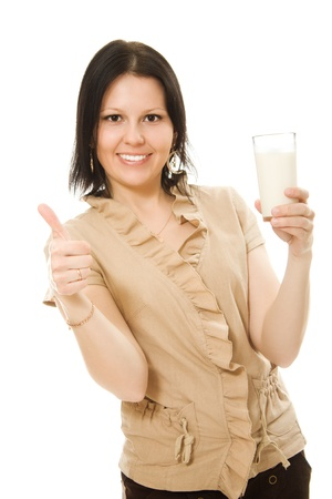 Woman drinking milk on a white background. photo