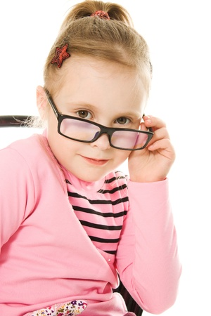 The little girl in glasses on a white background. photo