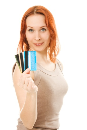 Woman with many different credit cards. Isolated on white. Stock Photo - 13969176