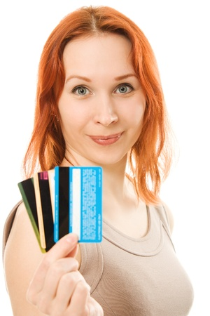 Woman with many different credit cards. Isolated on white. Stock Photo - 13969302