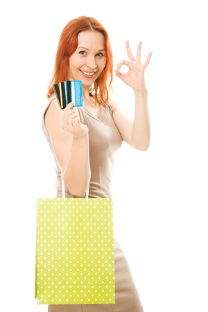 Woman with many different credit cards and shopping. Isolated on white. Stock Photo - 13968973
