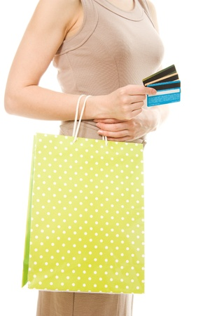 Woman with many different credit cards and shopping. Isolated on white. Stock Photo - 13954577