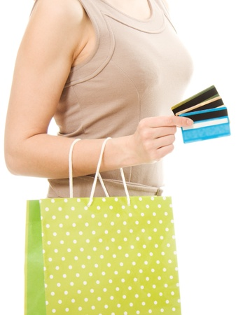Woman with many different credit cards and shopping. Isolated on white. photo