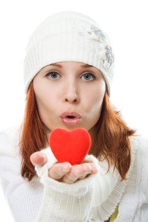A beautiful woman sends a kiss in the form of the heart photo