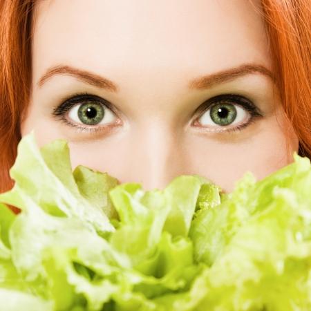 young beautiful  woman eating salad close up Stock Photo - 13969297