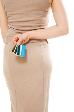 Woman with many different credit cards behind his back. Stock Photo - 13954593
