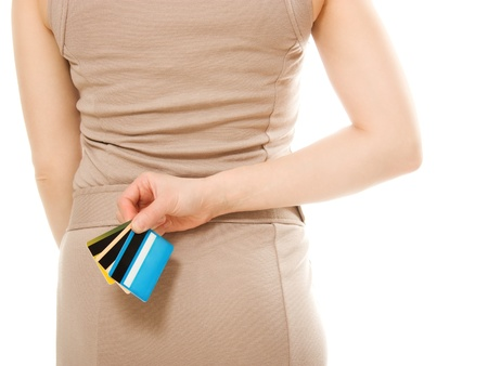 Woman with many different credit cards behind his back. photo