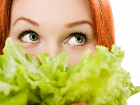 welfare plant: young beautiful  woman eating salad close up